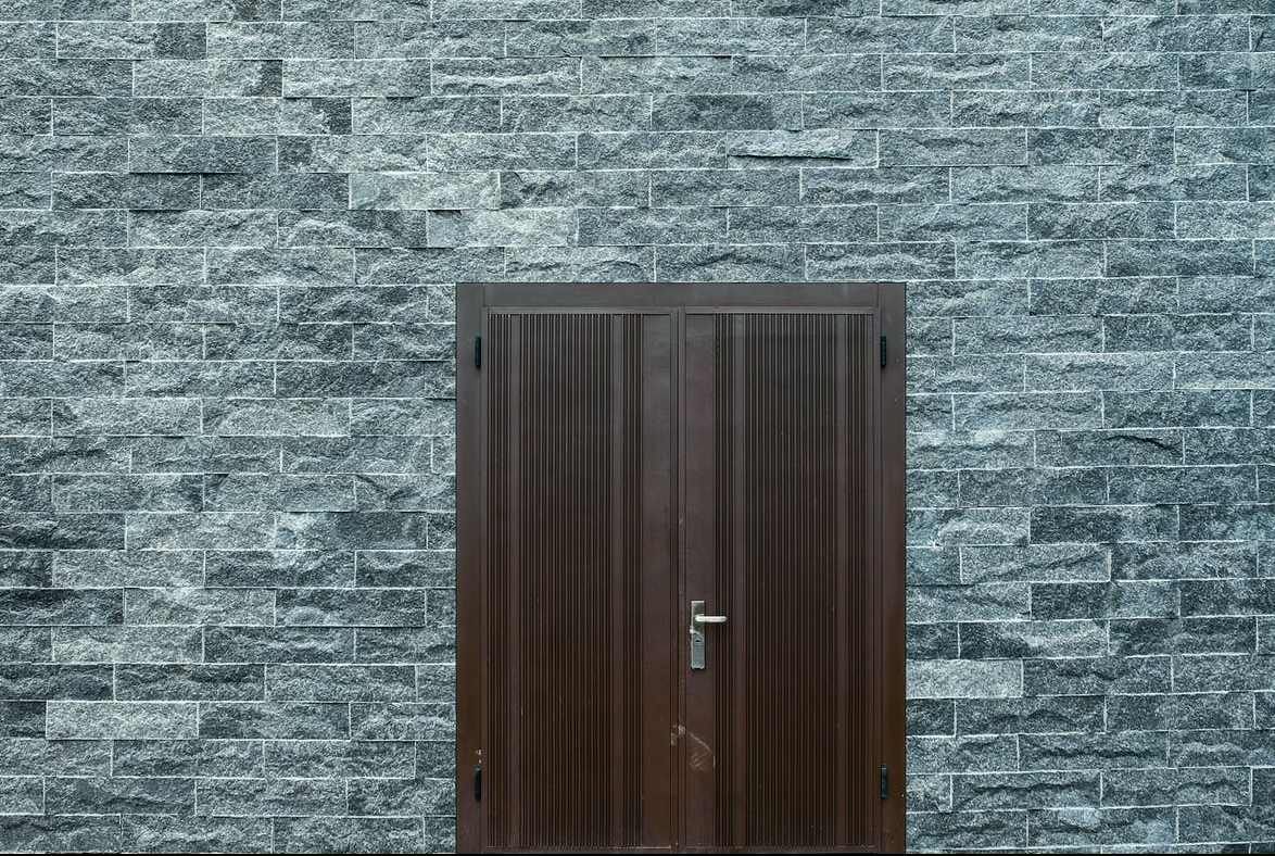 brown wooden door on a flat bricked wall
